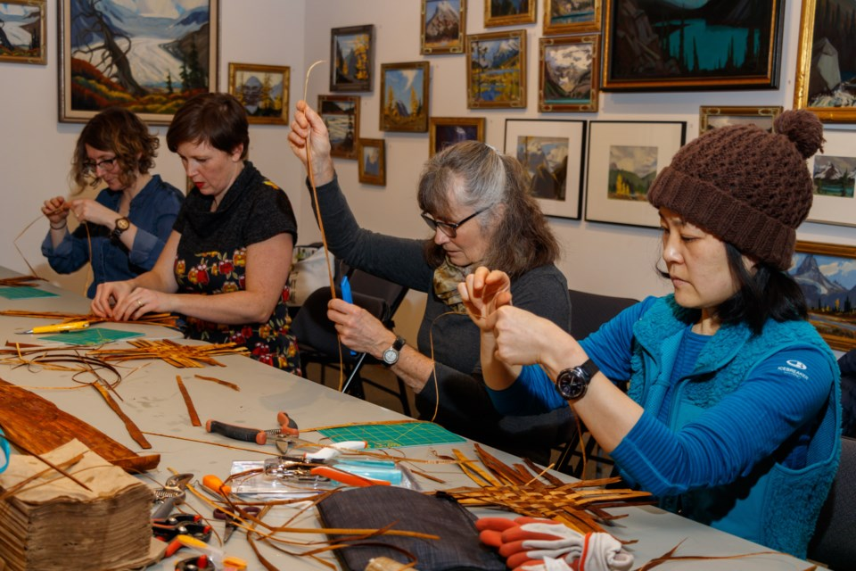 Daniella Rubeling, left, Tangle McClaron, Heather Dempsey and Asami Yamauchi participate in a introduction to Indigenous basket making class at the Whyte Museum of the Canadian Rockies on Wednesday (Jan. 22). The class was led by teacher Lillian Rose of the Ktunaxa Nation who used hands on experience to help students create cedar baskets. The event marked the kick-off for new cultural programming coming to the museum that aims to build bridges with Indigenous artists, filmmakers, speakers and community members as a way to celebrate the traditional Bow Valley cultural trade routes. The event was followed by a talk from Stoney Nakoda Nation member and cultural advisor and travel historian Buddy Wesley. CHELSEA KEMP RMO PHOTO