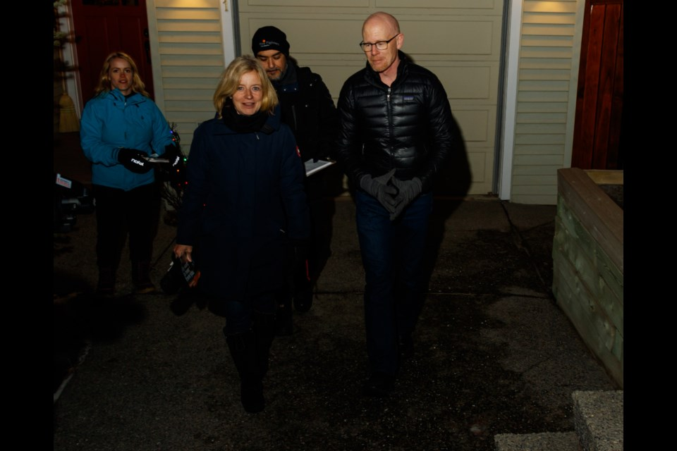 NDP leader Rachel Notley, left, and Banff-Kananaskis constituency association president Stephen Legault go door knocking in Banff on Tuesday, Jan. 28, 2020.  CHELSEA KEMP RMO PHOTO