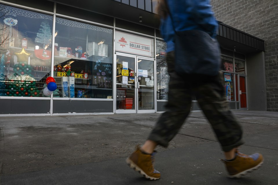 A pedestrian walks past the Great Canadian Dollar Store on Main Street in Canmore on Tuesday (Jan. 12). The popular dollar store is closing its doors. EVAN BUHLER RMO PHOTO