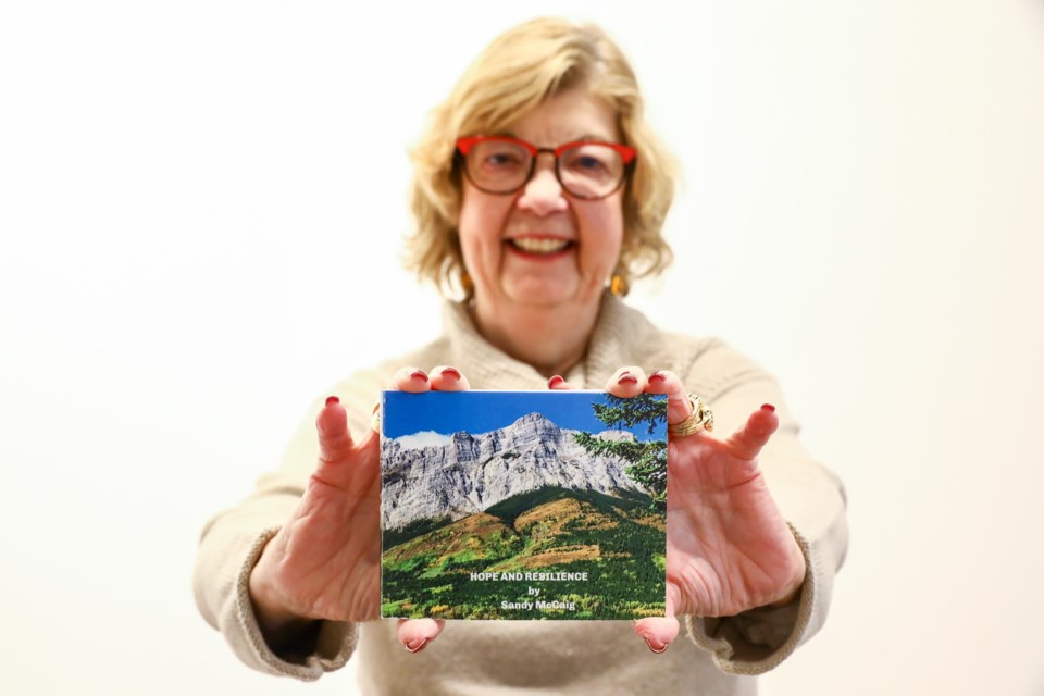 Sandy McCaig is submitting her picture book Hope and Resilience to artsPlace's upcoming exhibit Stories of Resilience, which focuses on artwork created during the pandemic. McCaig created the book last March during the beginning of the lockdown through an online class offered at artsPlace led by photographer Stephen Legault. EVAN BUHLER RMO PHOTO