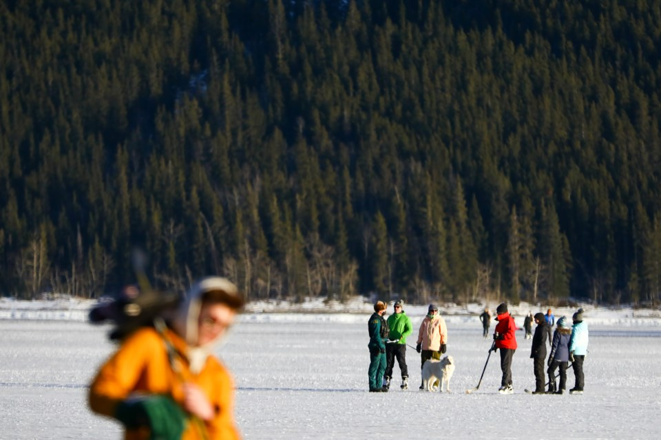 Hundreds of people skate on Lake Minnewanka in Banff National Park on Saturday (Jan. 23). Over the past 48 hours, four people have fallen through the ice at the popular skating spot. EVAN BUHLER RMO PHOTO