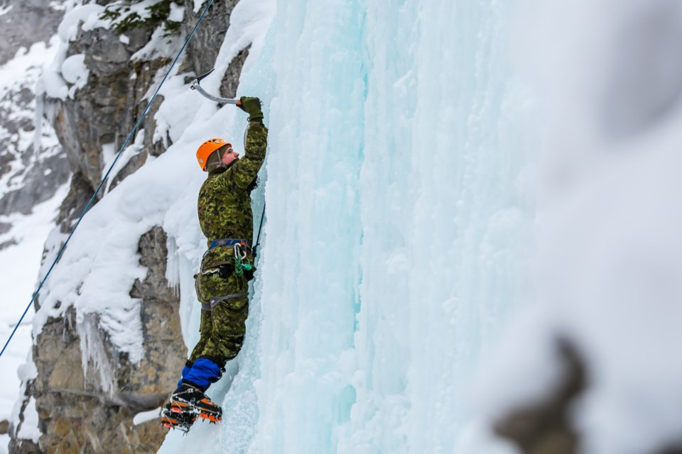 Trooper Ryan Bridge of the Canadian Armed Forces from 41 Canadian Brigade Group ice climbs at King Creek in Kananaskis on Tuesday (Feb. 16). The week-long training focused on ice climbing, snowshoeing, and backcountry skiing under the guidance of Yamnuska Mountain Adventures. EVAN BUHLER RMO PHOTO