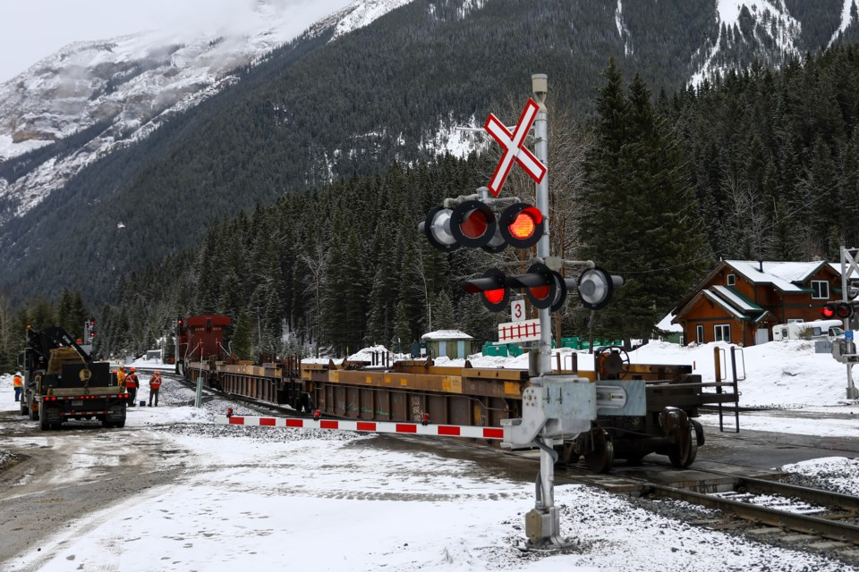 Three empty train cars that derailed are hooked up and moved out of the way in Field, B.C. on Saturday (March 20). EVAN BUHLER RMO PHOTO