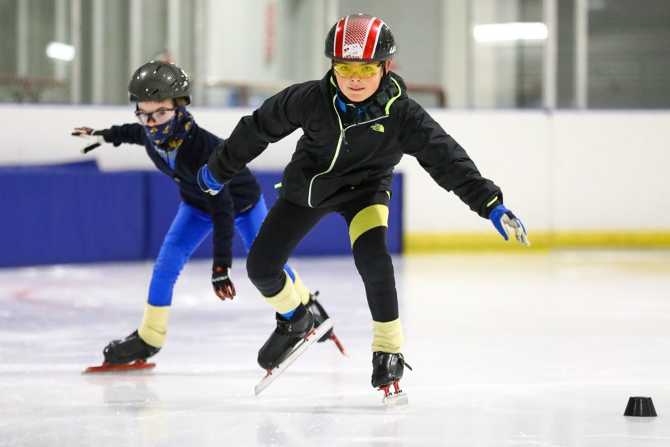 Micah Sovereign, left, and Lucas Kay attempt to catch Speed Skating Canada team member Connor Howe during a Banff Canmore Speed Skating Club practice at the Canmore Recreation Centre on Wednesday (March 24). Howe started skating at the local club and returned to help out at the practice. EVAN BUHLER RMO PHOTO