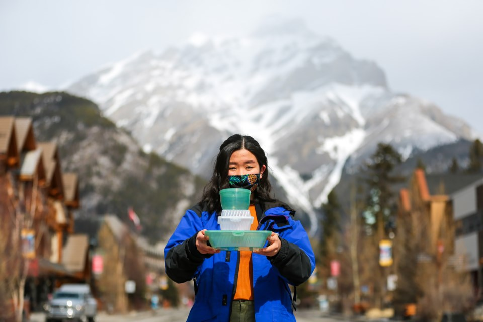 University of Waterloo student Luna Kawano shows off a collection of reusable container prototypes for her upcoming Banff Isn't Disposable program on Friday (March 26). The program's aim is to have restaurants and businesses in the Bow Valley to utilize reusable containers to reduce waste. EVAN BUHLER RMO PHOTO