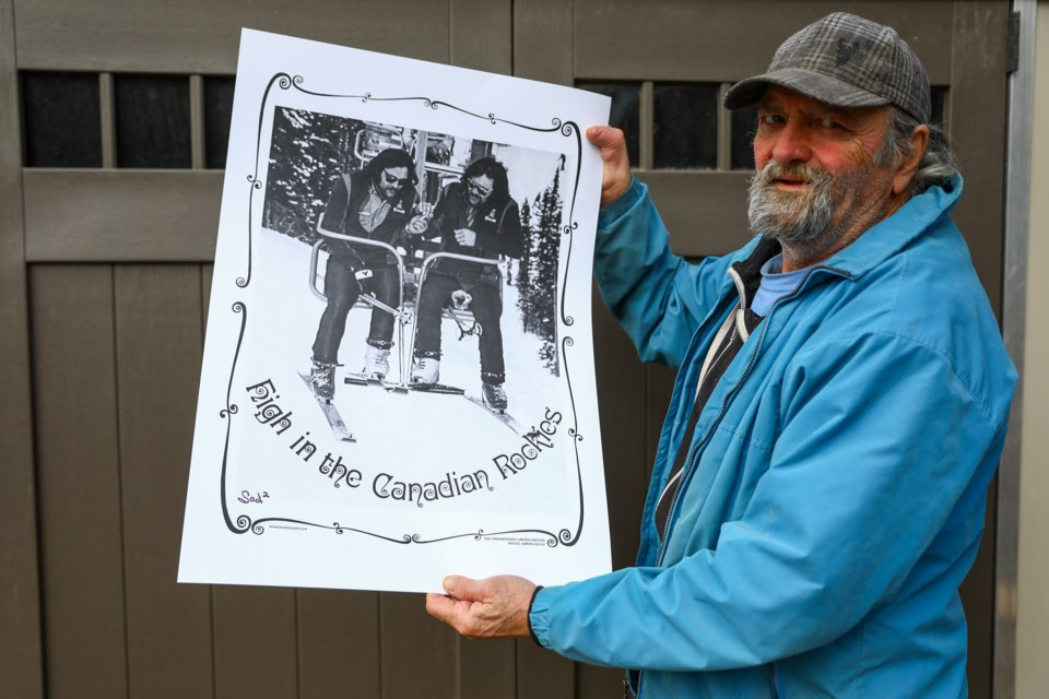 """Don Sadoway poses with a """"High in the Canadian Rockies"""" poster on Saturday (March 27). EVAN BUHLER RMO PHOTO"""