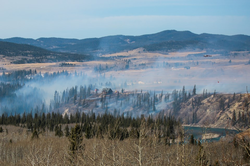 April has already seen large southern Alberta grass fires.  An Alpine Helicopter aerially assists firefighters on the ground as a wildfire burns near a residence off of Highway 1A, about one kilometre west of the The Wildcat Hills Gas Plant on Thursday (April 1). EVAN BUHLER RMO PHOTO