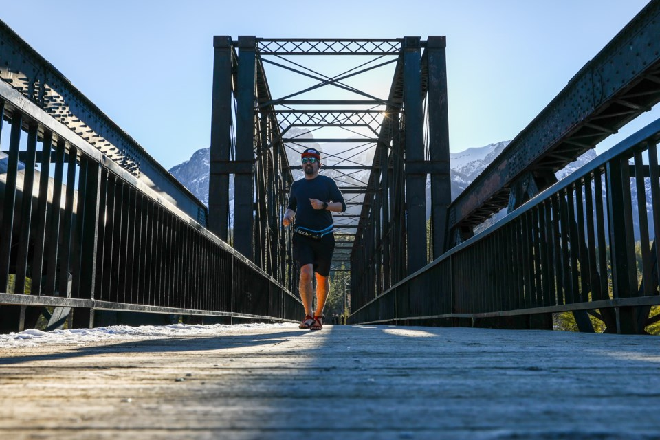 Joseph Michael Kaitsu Liu runs along Engine Bridge while training for his upcoming 1,500km long run in the Yukon as part of his Run2theEnd project on Tuesday (April 13). EVAN BUHLER RMO PHOTO