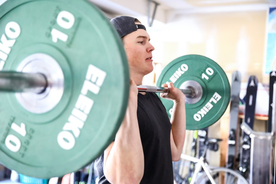 Alpine Canada athlete Jeff Read lifts weights at home in the garage on Thursday (April 15) due to COVID-19 restrictions on gyms. EVAN BUHLER RMO PHOTO
