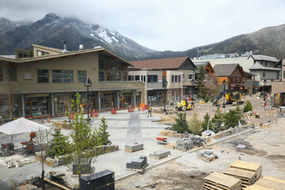 Construction workers work on laying down the pavement stones along Bear Street in Banff on Thursday (May 20). EVAN BUHLER RMO PHOTO