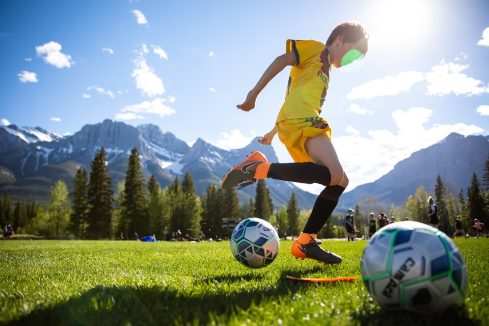Ryan Orchard completes a ball control drill during Canmore Minor Soccer's return to field event at Millennium Field on Tuesday (June 1). Children were divided into age groups and into smaller groups of eight during the first practice of the year. EVAN BUHLER RMO PHOTO