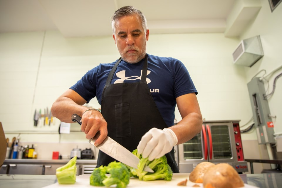 Chef and owner of Mountain Fire Foods Damian Liengme prepares a set of meals for delivery on Tuesday (June 1). EVAN BUHLER RMO PHOTO