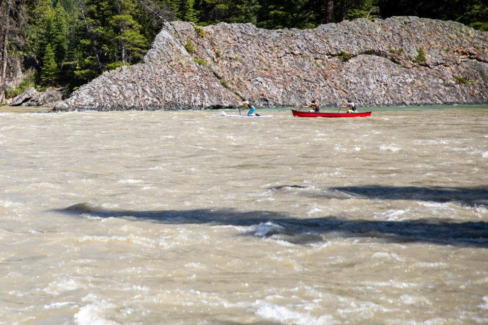 A group of paddlers launch into a raging Bow River downstream of Bow Falls on Friday (June 4). EVAN BUHLER RMO PHOTO