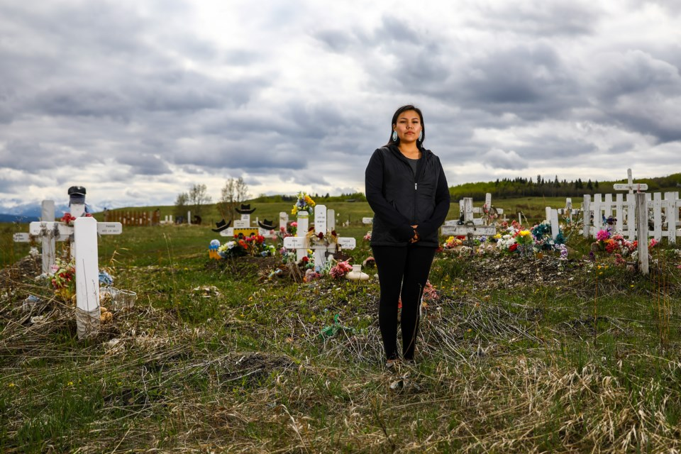 Summer Twoyoungmen of the Stoney Nakoda First Nation, and activist against drug dealers and organizer of the Battle Against Drugs Walk, stands in the Wesley Cemetery where her mother, who died of a drug overdose, is buried. EVAN BUHLER RMO PHOTO