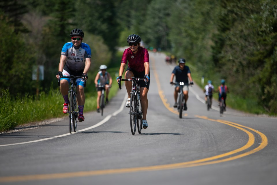 Cyclists ride along the bow Valley Parkway in Banff National Park on Saturday (July 3). EVAN BUHLER RMO PHOTO