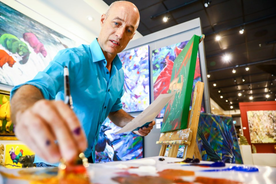 Calgary-based artist Keith Dalgleish paints during an artist demo at Avens Gallery in Canmore on Saturday (July 17). EVAN BUHLER RMO PHOTO