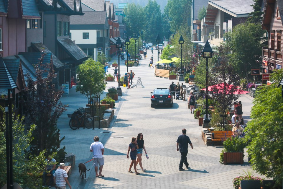 Pedestians and vehicles  share the road on the newly finished Bear Street in Banff on Tuesday (July 20). EVAN BUHLER RMO PHOTO