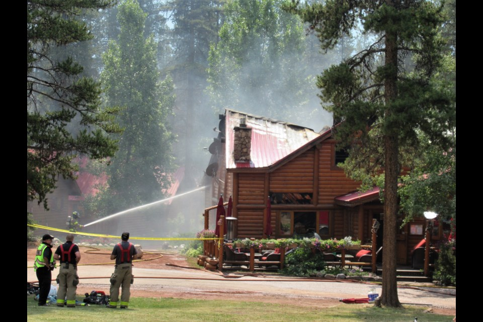 A fire that broke out at Baker Creek Mountain Resort during the early morning hours of Sunday (July 25) destroyed the Bistro restaurant building.  Bruce Scott/Special to the Outlook