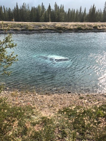 Two women were lucky to escape with their lives after their vehicle plunged into the Spray Lakes reservoir canal near Goat Pond.  Handout