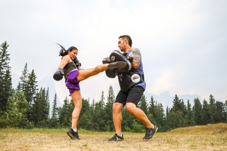 Banff's Maddie MacPherson punches and kicks the pads with trainer Ki Cardinal in Canmore in preparation for Saturday's (Sept. 4) Muay Thai fight in Calgary. EVAN BUHLER RMO PHOTO