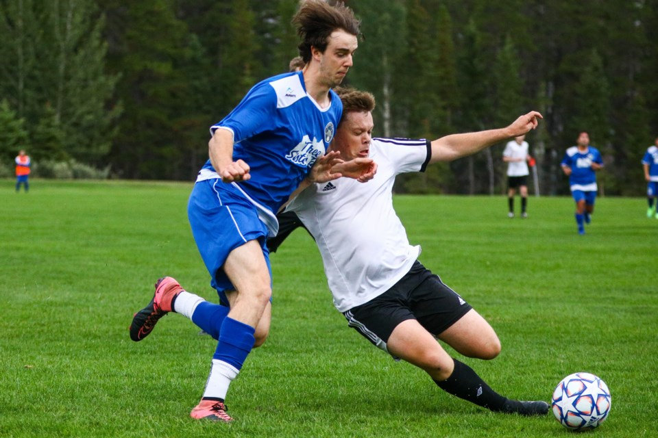 Rowan Rockley, left, of Rundle FC get tackled by Shane Collins of Earl's/Banff Springs during a match at Our Lady of the Snows field on Thursday (Aug. 19). Earl's/Banff Springs would go on to win the match 4-1. EVAN BUHLER RMO PHOTO