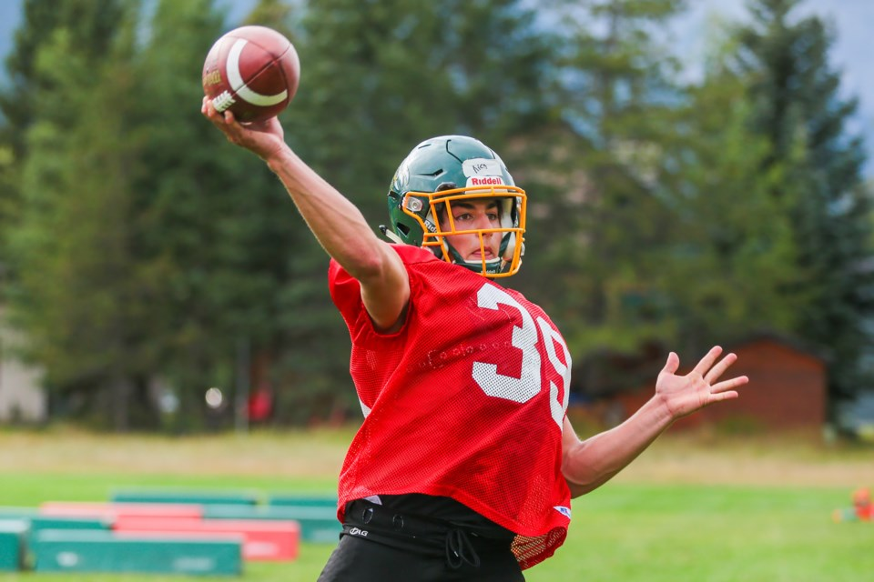 Canmore Wolverines quarterback Nico Hornyansky throws the ball during practice at Lions Park field on Friday (Aug. 20). The Wolverines football team is the first team at Canmore Collegiate High School to resume to play after a year without organized sports at the high school level due to COVID-19. EVAN BUHLER RMO PHOTO