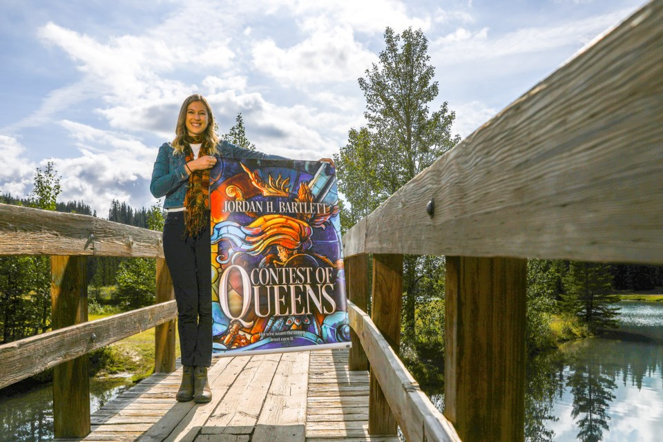 Banff author Jordan Bartlett reveals the cover artwork of her first fantasy novel, Contest of Queens, on Saturday (Aug. 21), which will be published in January. The novel is now available to pre-order. EVAN BUHLER RMO PHOTO