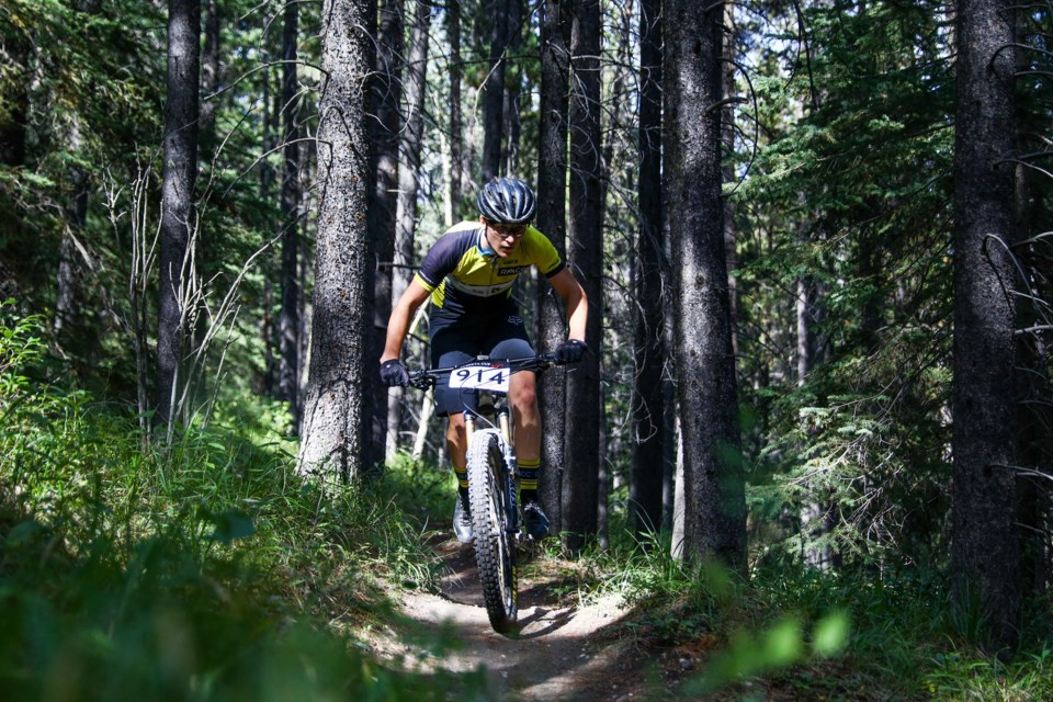 Logan Sadesky flies down the Killer Bees track while cycling in the open category of the Ziggy Gnarley Enduro race at the Canmore Nordic Centre in Canmore on Saturday (Aug. 28). Sadesky finished first place in the endure race and claimed second in the six-hour marathon the following day. EVAN BUHLER RMO PHOTO