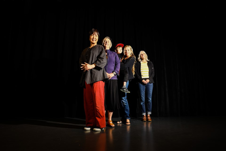 Bow Valley Local Coordinator of the Shoe Project Noriko Oshada, left, founder of the Shoe Project Katherine Govier, Shoe Project Participant Antonina Natalukha with her son Erik and writing mentor Helen Rolfe pose for a portrait on Tuesday (Aug. 31). The Shoe Project returns to artsPlace on Saturday, Sept. 11 at 7:30 p.m. and Sunday, Sept. 12 at 2 p.m. EVAN BUHLER RMO PHOTO