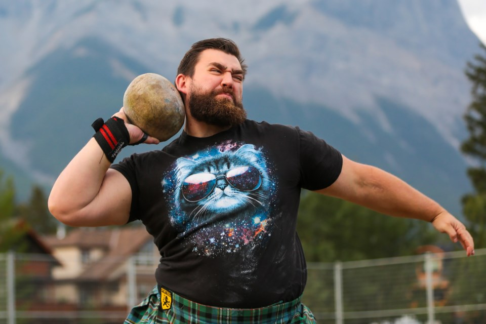 Robert Scott competes in the elite division stone put during the Scottish heavy events at the Canmore Highland Games on Sunday, September 5, 2021. EVAN BUHLER RMO PHOTO