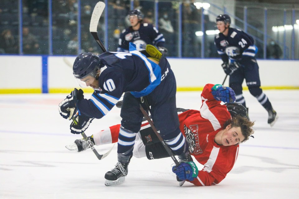 Nathan Ellis of the Canmore Eagles body checks a Whitecourt Wolverines player during an exhibition game at the Canmore Recreation Centre on Monday (Sept. 6). EVAN BUHLER RMO PHOTO