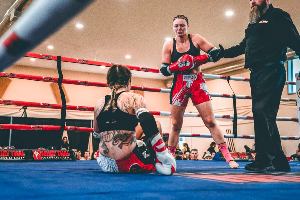 Banff's Maddie MacPherson, centre, defeated Saskatchewan's Charlene Clarke by technical knockout in her Canadian debut at the Muay Thai World Cup's Prospect Series at Bullhead Community Hall in Tsuut'ina First Nation near Calgary on Saturday (Sept. 4). SUBMITTED PHOTO