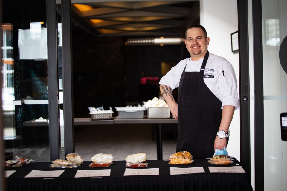 Sky Bistro Chef Scott Hergott stands by the at-cost Easy Eats meals, showcasing what will be available to the Bow Valley community through the new initiative that launched April 24. PHOTO SUBMITTED