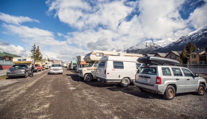 Canmore Bylaw and RCMP officers enforce parking bylaws in the alleyway that stretches from behind Save-on-foods to Elevation Place in Canmore in May 2019. RMO FILE PHOTO