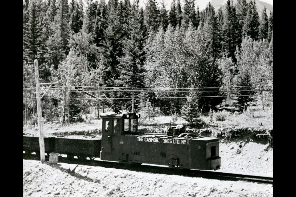 Canmore Mines Ltd. narrow gauge electric locomotive hauling coal from the No. 3 Mine to the tipple at the No. 2 Mine.