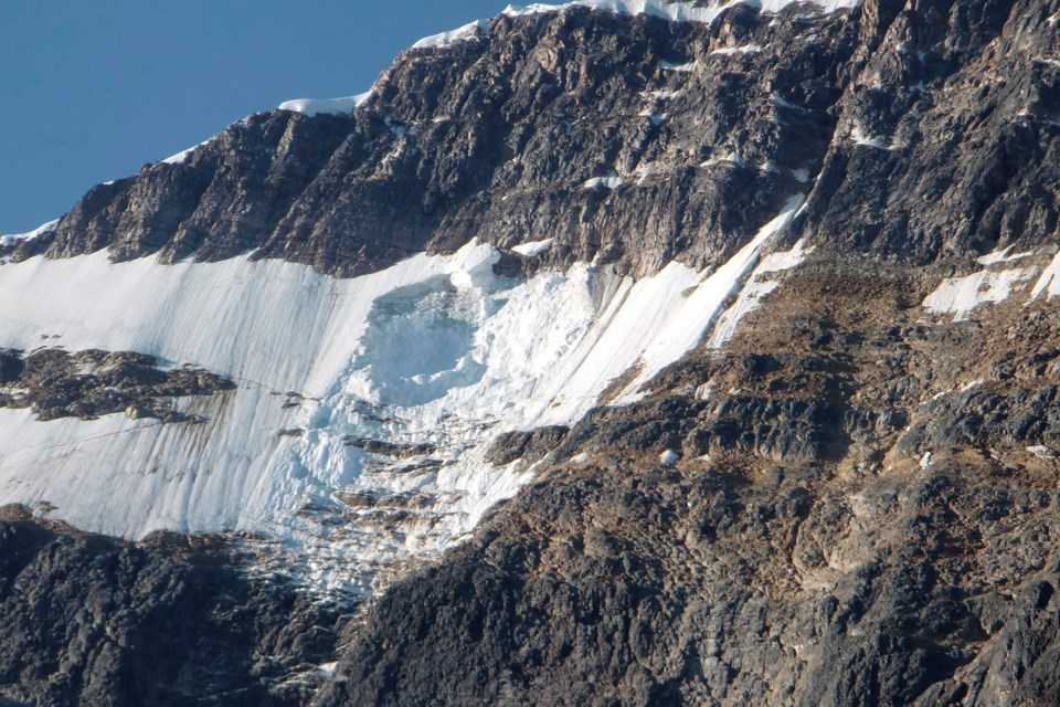 A chunk of the Ghost Glacier, pictured on Aug. 11, 2012, fell into Cavell Pond overnight. The incident created a wave that destroyed the nearby parking lot and road. PARKS CANADA PHOTO