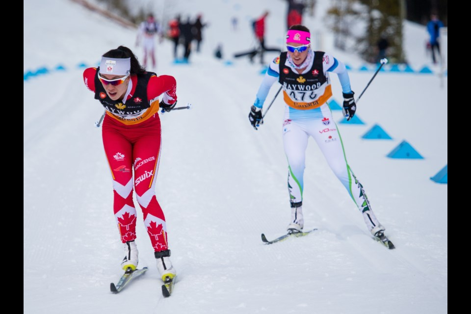 Emily Nishikawa, left, races ahead of Katherine Stewart-Jones in the open women's medium interval sprint race at the 2017 Ski Nationals at the Canmore Nordic Centre. RMO FILE PHOTO