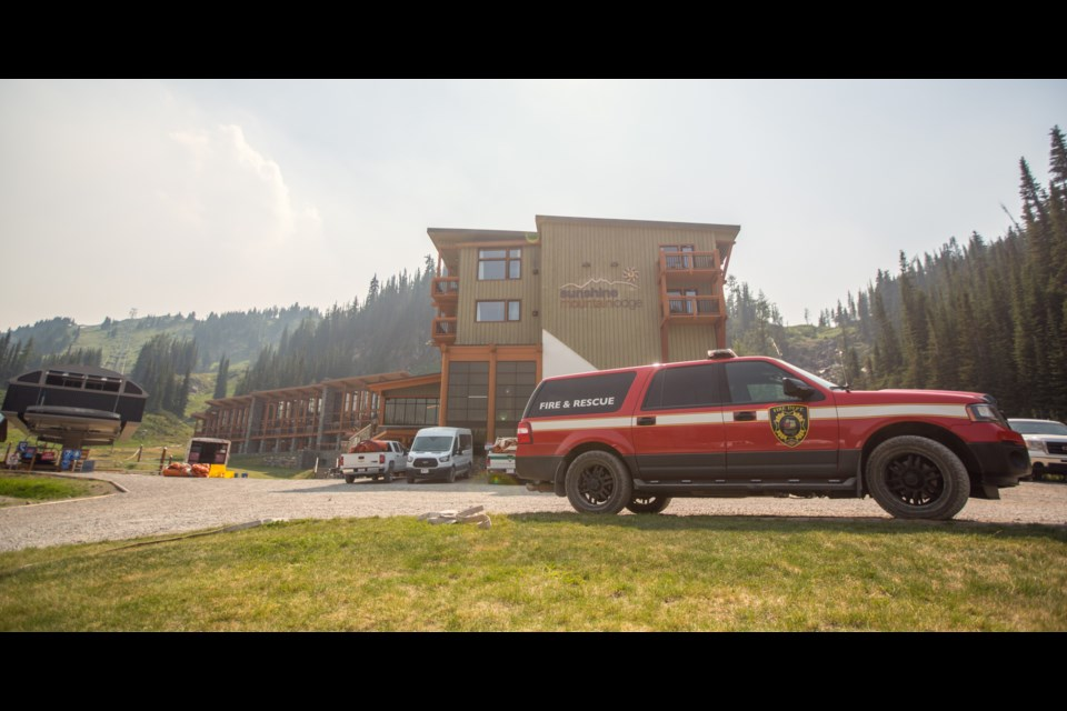 Parks Canada and Banff Fire Department members put out sprinklers and hose at Sunshine Village in July 2017. Canmore and Banff are applying for a provincial grant to set up a regional emergency management plan