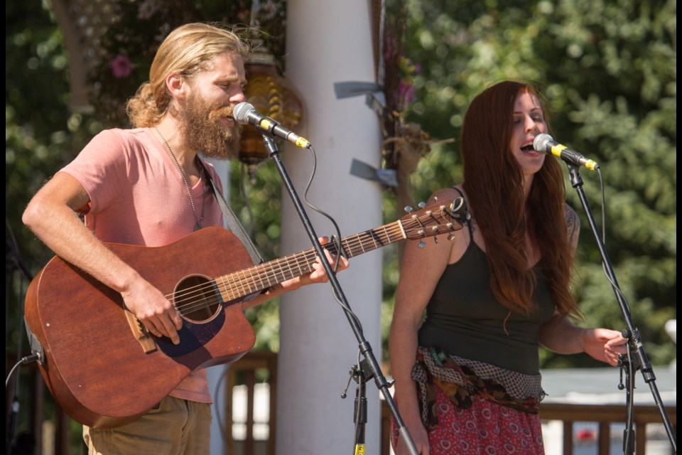 Brandon Johnas, left, and Caitlin Connelly of Johnas and Connelly performing at the Harvest Festival in Banff. The festival is now renamed the Banff Mountain Music Festival. RMO FILE