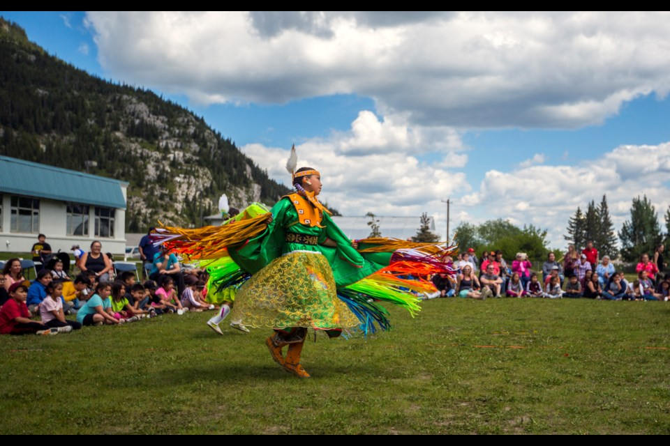 The Stoney Nakoda community raises a tipi and holds a powwow at Exshaw School in June 2018. Changes to how the federal government funds Indigenous education in Canada have caused concerns for the Canadian Rockies School division, parents and teachers at the school. RMO FILE PHOTO