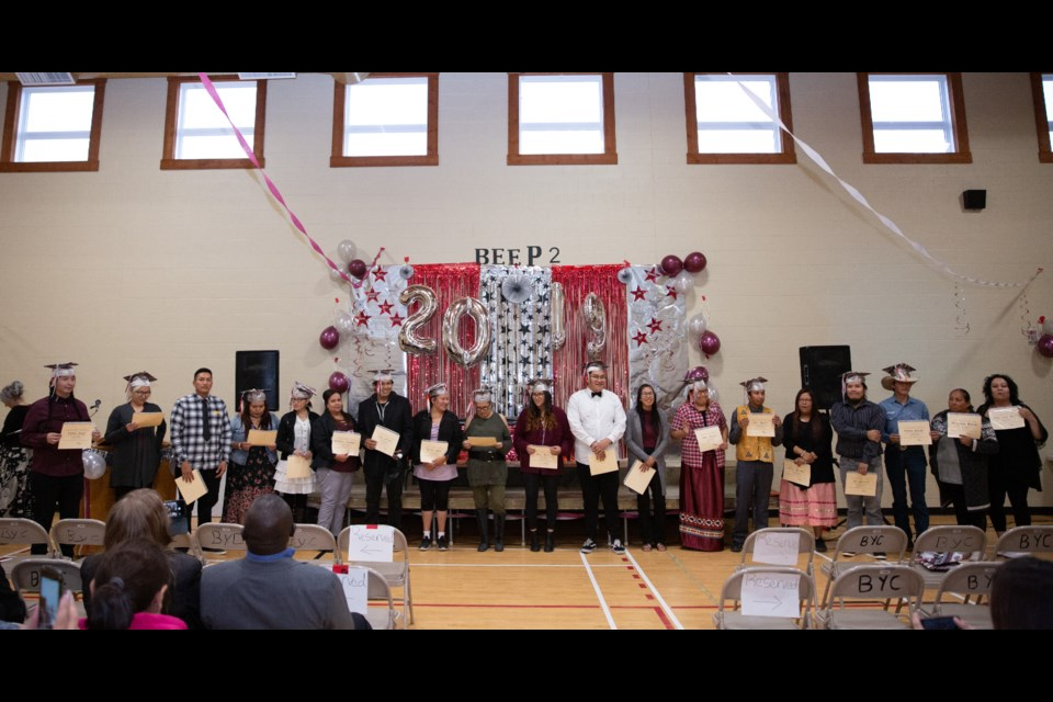 Students from the Bearspaw Empowerment Employment Program receive their diplomas during their graduation ceremony at the Bearspaw Youth Centre in Morley on Thursday (Sept. 26). EVAN BUHLER RMO PHOTO