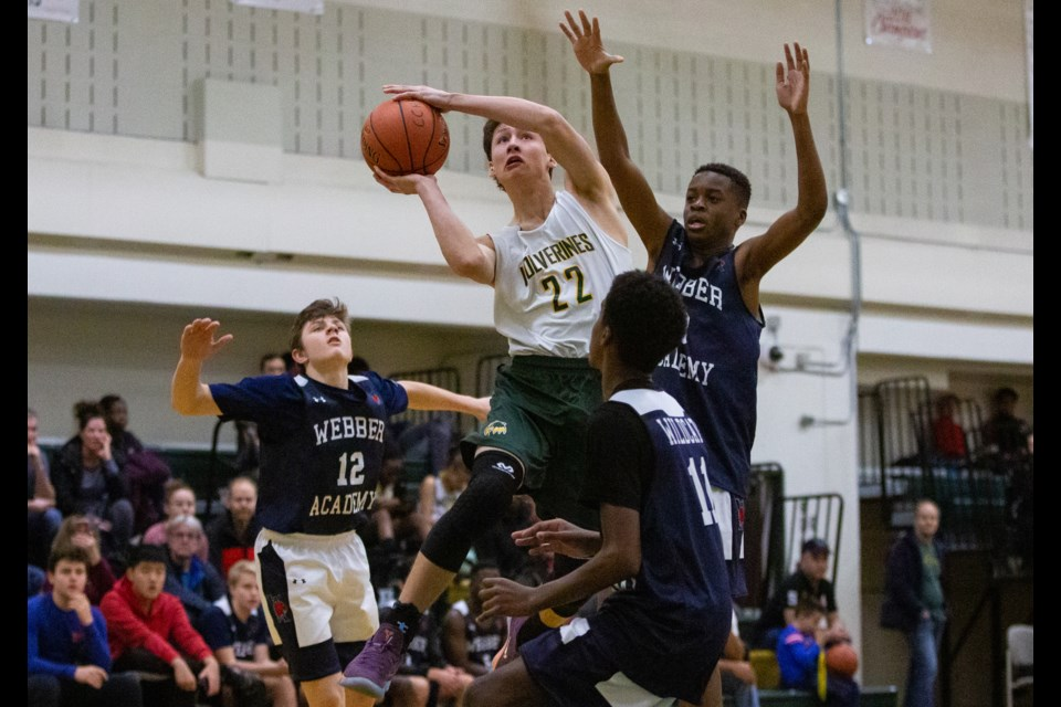 Ethan Fisher of the Canmore Wolverines grade 9 basketball team charges to the basket in a game against Webber Academy during a tournament at Canmore Collegiate High School on Saturday (Dec. 14). EVAN BUHLER RMO PHOTO⁠