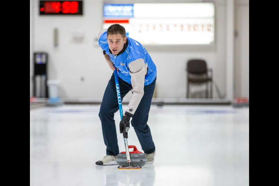 Olympic champion John Morris sweeps a rock into the house during the first match of the 2020 Qualico Mixed Doubles Classic at the Canmore Golf and Curling Club on Jan. 2, 2020. EVAN BUHLER RMO PHOTO