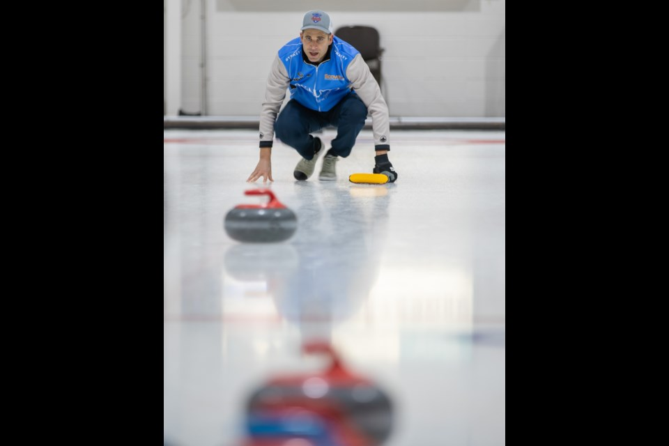 Olympic champion John Morris watches his rock as it enters the house during a match at the 2020 Qualico Mixed Doubles Classic at the Canmore Golf and Curling Club on Friday (Jan. 3). EVAN BUHLER RMO PHOTO