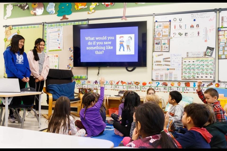 Banff Elementary School Grade 8 students Chelsea Dela Pena, 14, left, and Jana Delos Santos, 14, give a presentation to kindergarten students on bullying last Tuesday (Jan. 28). CHELSEA KEMP RMO PHOTO