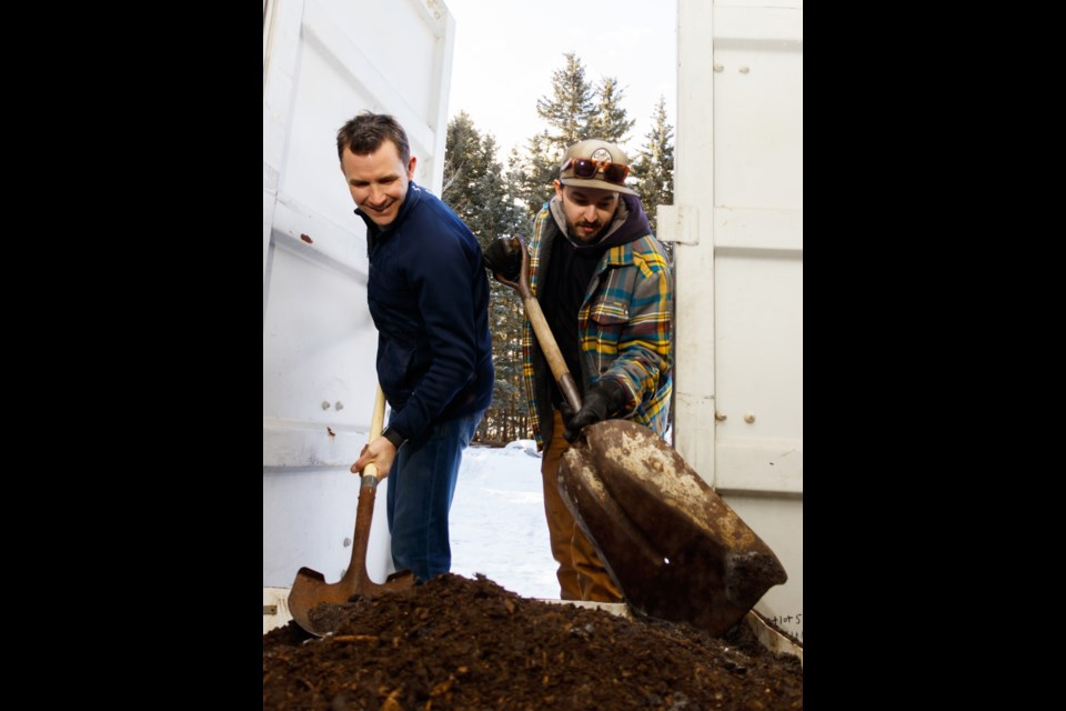 Reid Solodan, left, and Pete Dall dig into some soil created from their unique vermicomposting system on Monday (Feb. 10). CHELSEA KEMP RMO PHOTO