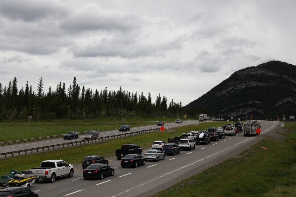 Vehicles are seen stopped on the Trans-Canada Highway Thursday (July 2) while emergency services respond to an injured cyclist. In order to allow STARS air ambulance to land, Canmore RCMP closed the highway temporarily. EVAN BUHLER RMO PHOTO