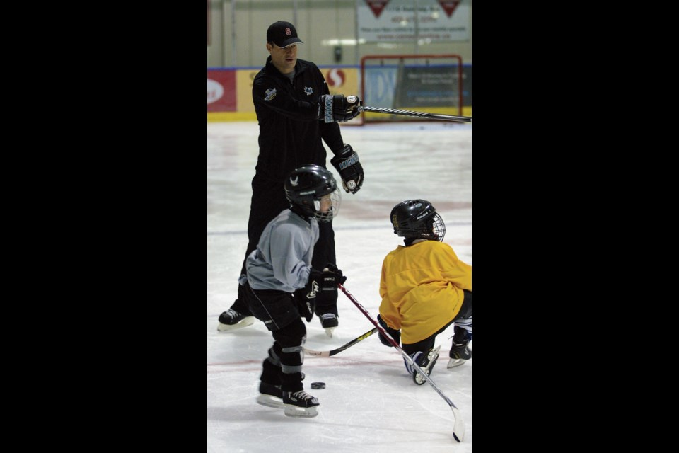 Patrick Marleau, a member of the Pittsburgh Penguins, instructs five- to seven-year-old hockey players on where to go before attempting a passing drill at the Canmore Recreation Centre in 2014. Marleau helped the Canmore Eagles with its summer hockey camp at the rec centre. RMO FILE PHOTO