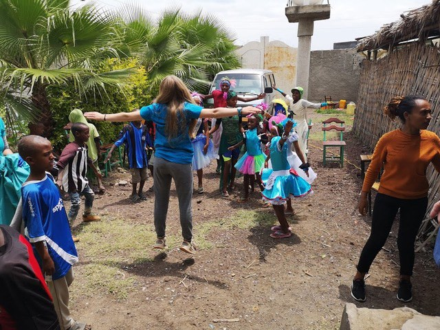 Brodie Moldenhauer running some exercise activities with children during a family humanitarian trip. SUBMITTED PHOTO