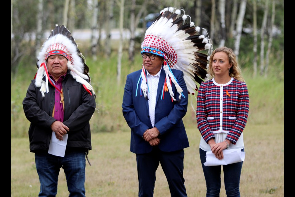 Stoney Nakoda chiefs Clifford Poucette of the Wesley band, left, and Aaron Young of the Chiniki band, and Banff-Kananaskis MLA Miranda Rosin at the renaming Alberta mountain peak ceremony in Canmore on Monday (Aug. 23). JORDAN SMALL RMO PHOTO
